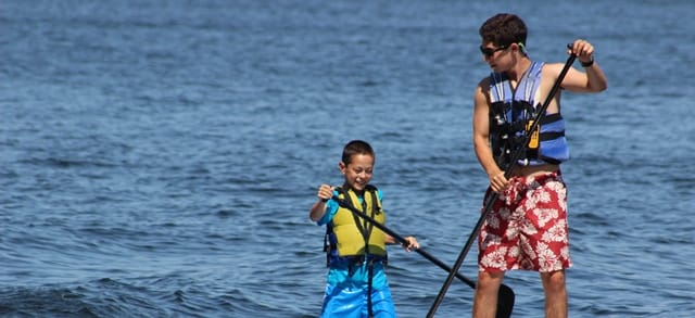 Smiling big brother paddleboard C and R