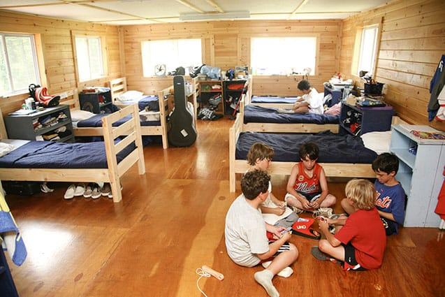 Campers playing cards in their bunk.